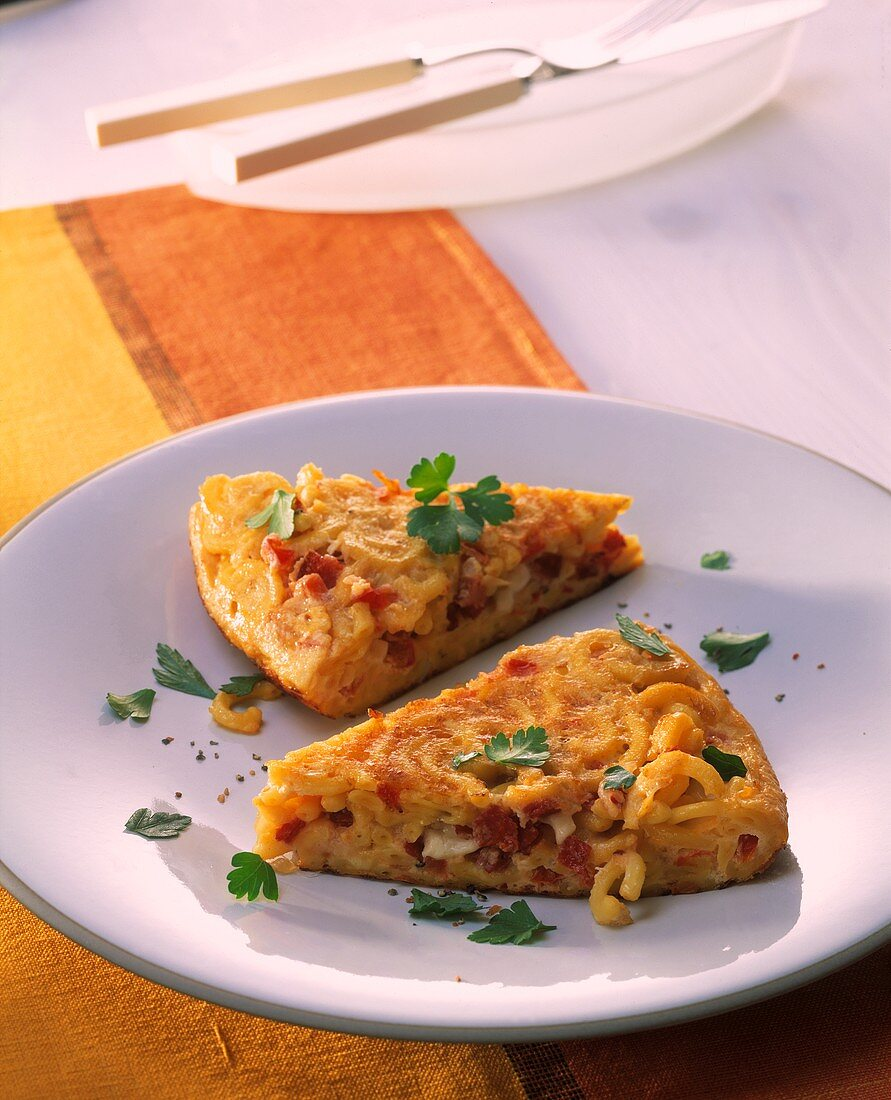 Pasta omelette with salami and mozzarella filling