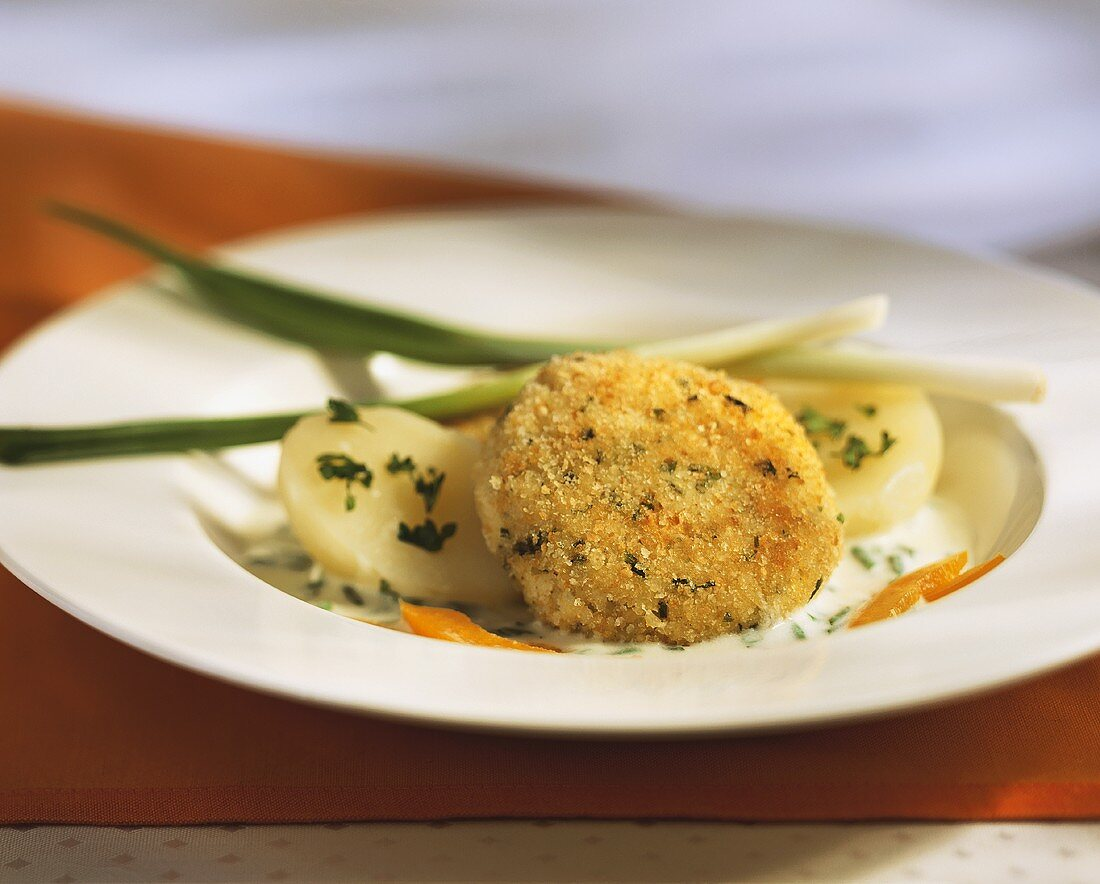 Millet burgers with boiled potatoes and chive sauce