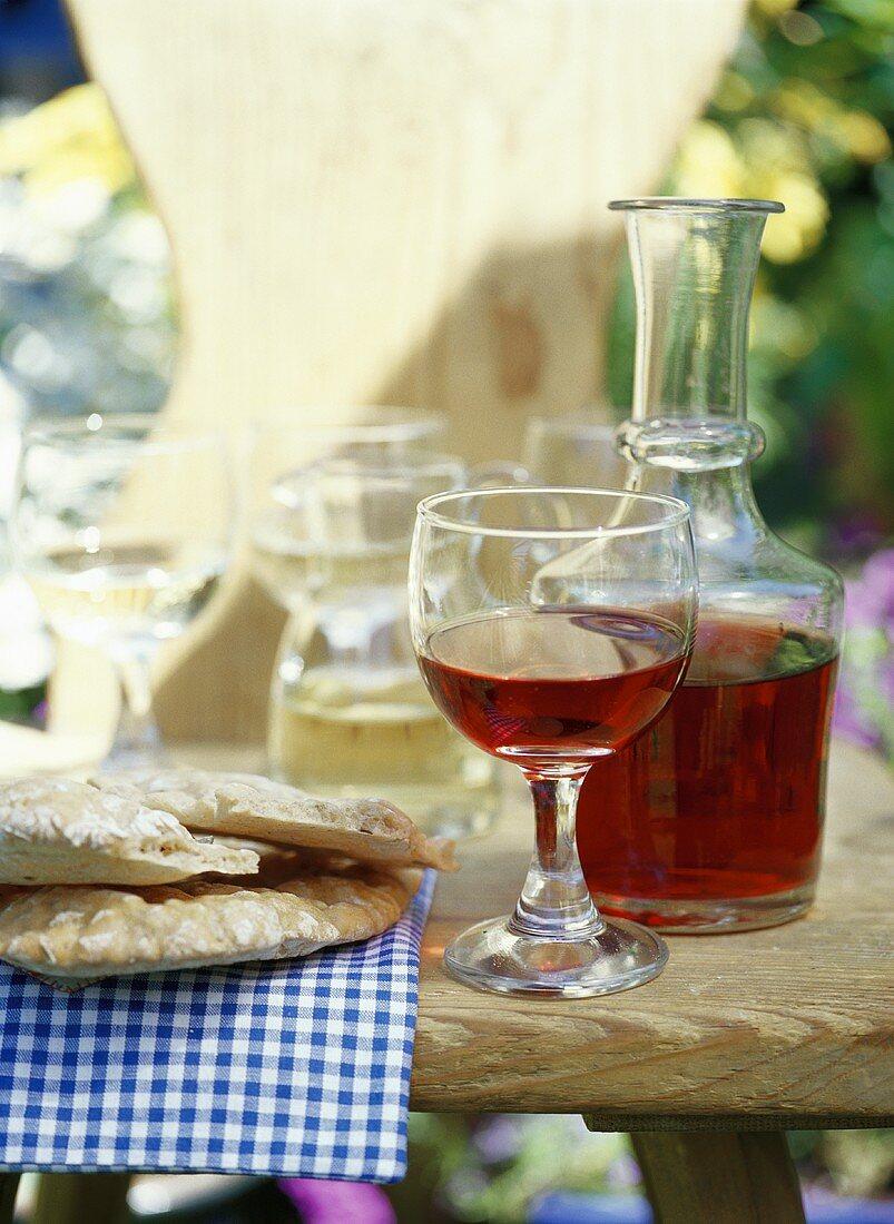 Red wine in glass & carafe, Schüttelbrot beside (S. Tyrol)