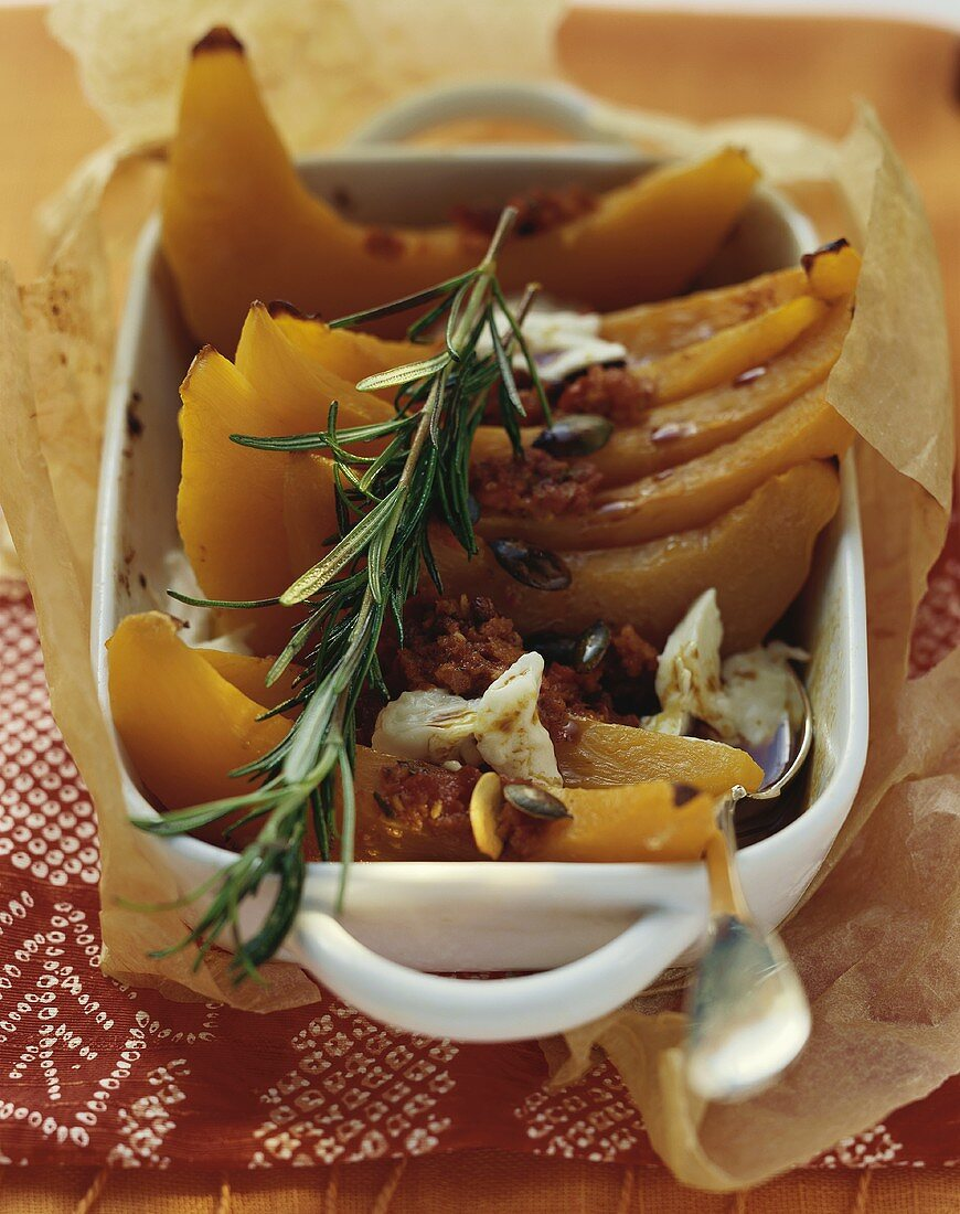 Oven-baked pumpkin slices with chilli paste and rosemary