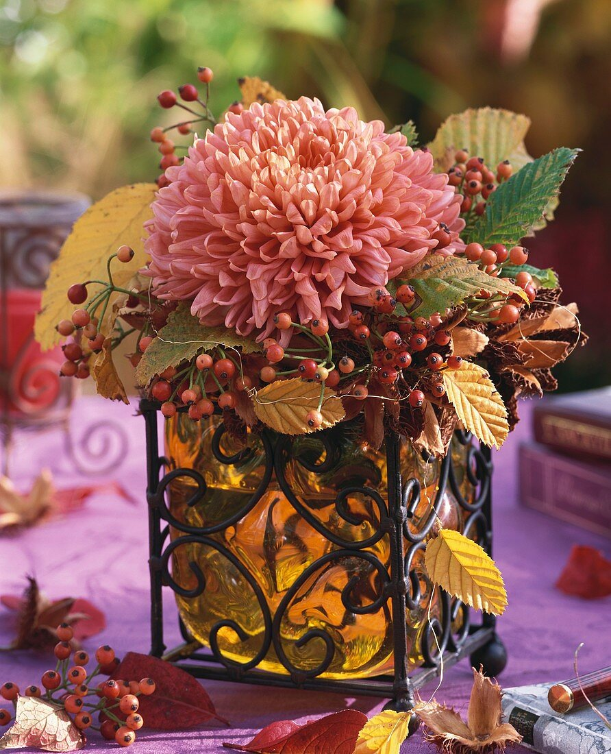 Autumn arrangement of chrysanthemums and rose hips