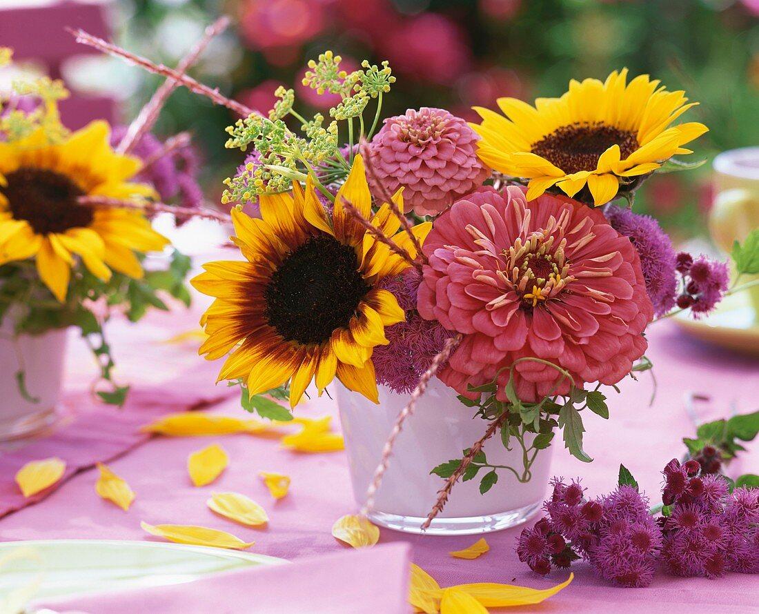 Vase of late summer flowers (sunflowers and zinnias)