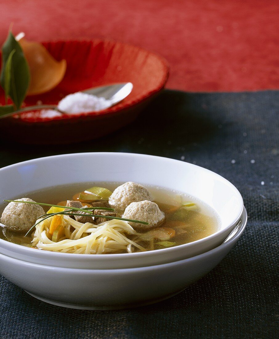 Beef bouillon with dumplings and noodles