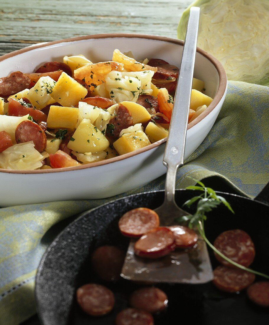 Swede and cabbage stew with sliced Mettwurst