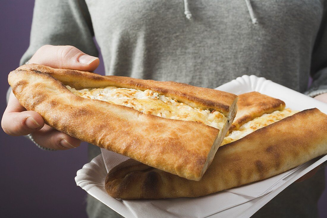 Pide (Turkish flatbread) with sheep's cheese filling