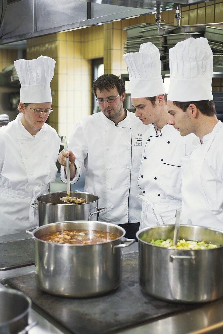 Chefs checking cooked vegetables