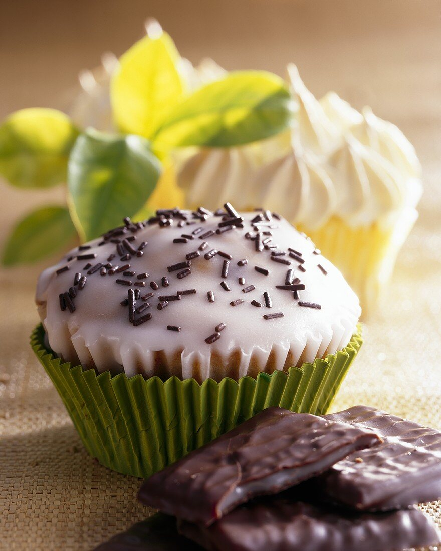 After Eight muffins with icing and chocolate sprinkles