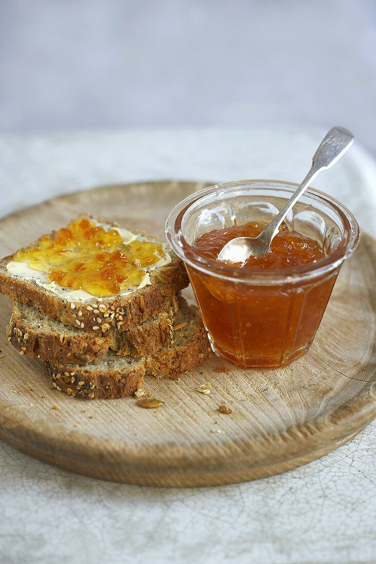 Slices of wholemeal bread and orange marmalade