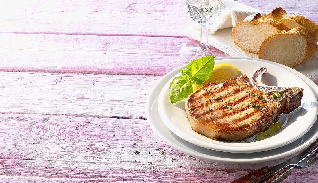 Grilled pork chop with basil and white bread