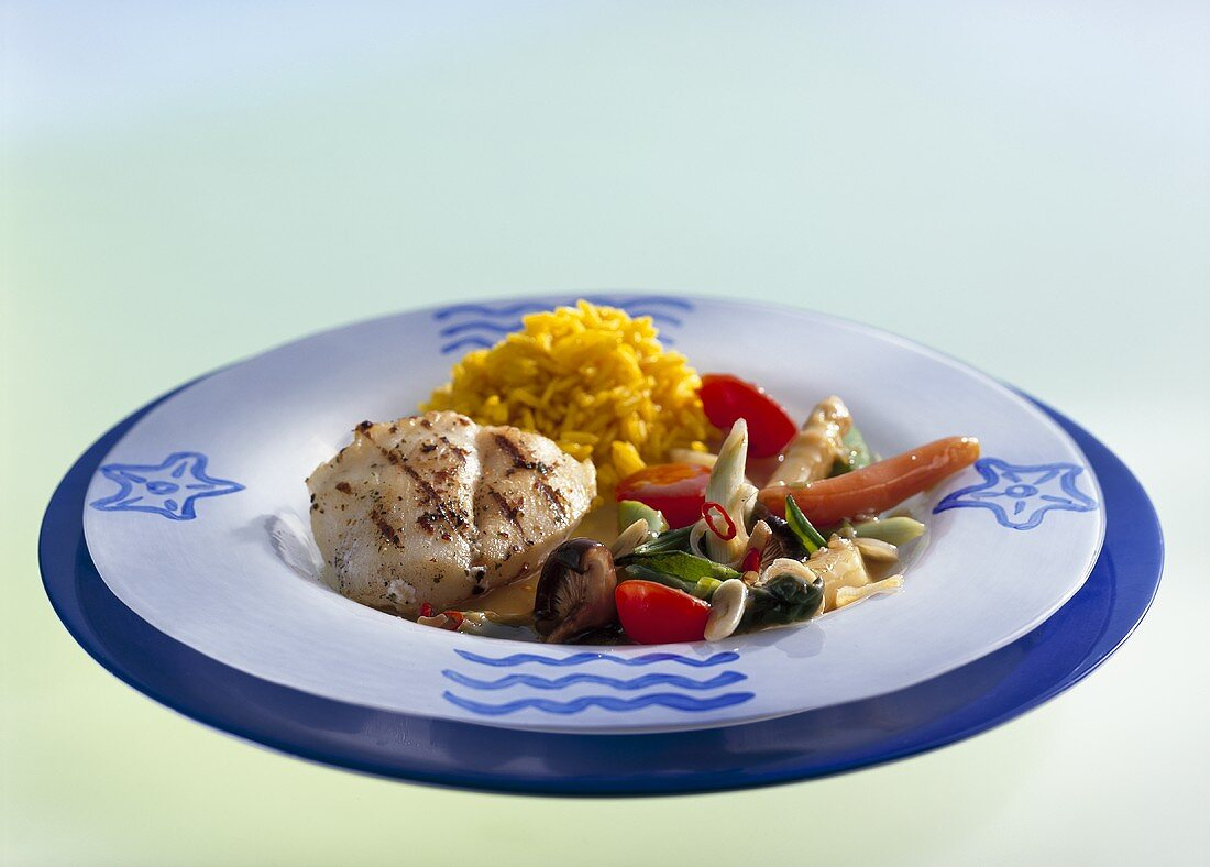 Monkfish cheek with Asian vegetables and curried rice