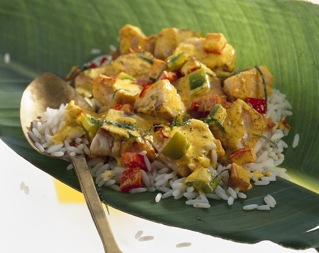 Fish curry with rice in banana leaf