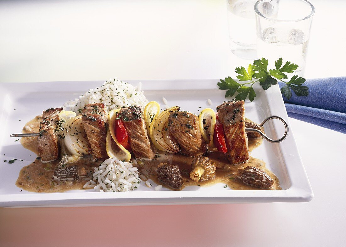 Veal kebab with morel cream sauce and rice