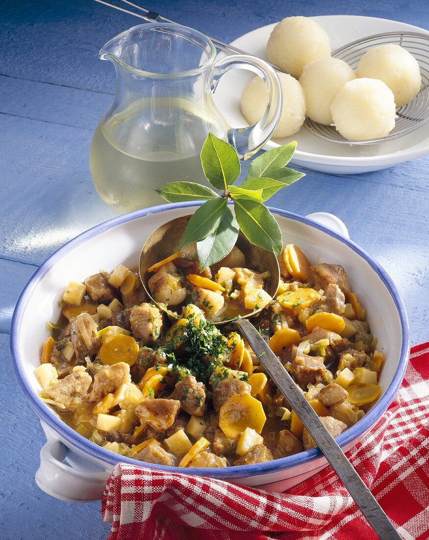 Pork stew (Schweinepfeffer) with potato noodles