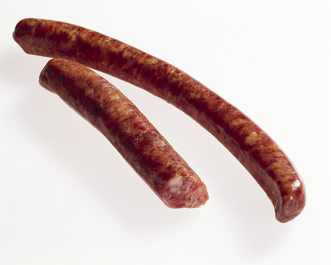 Two raw cured sausages (Stollberger Lerchen)