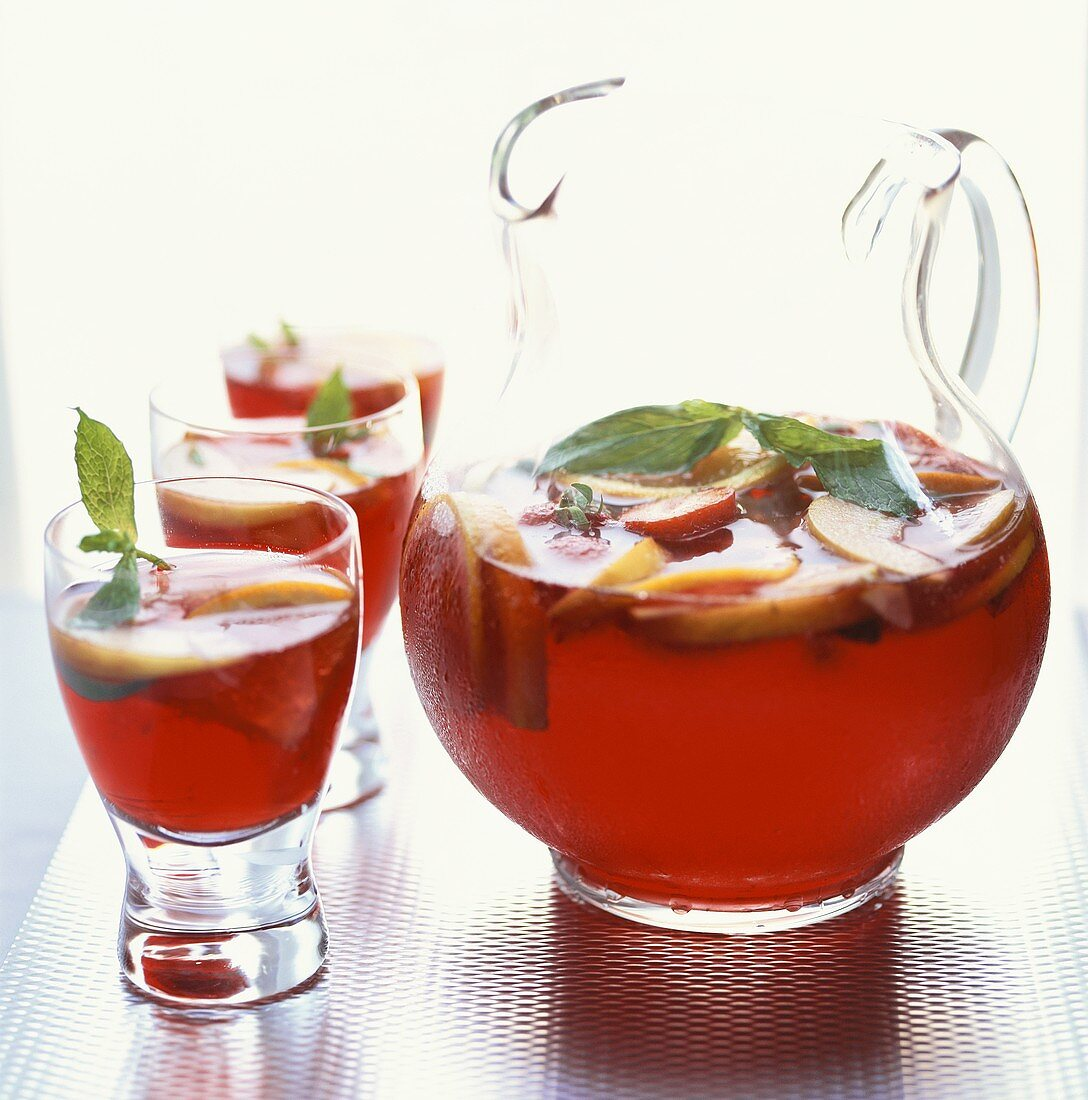 Sangria (red wine punch, Spain) in glass jug and glasses