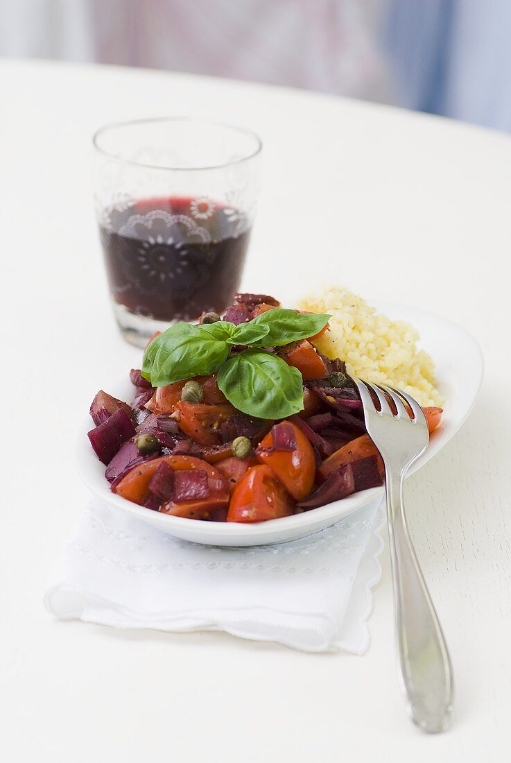 Bulgur with cherry tomatoes and onions in red wine sauce
