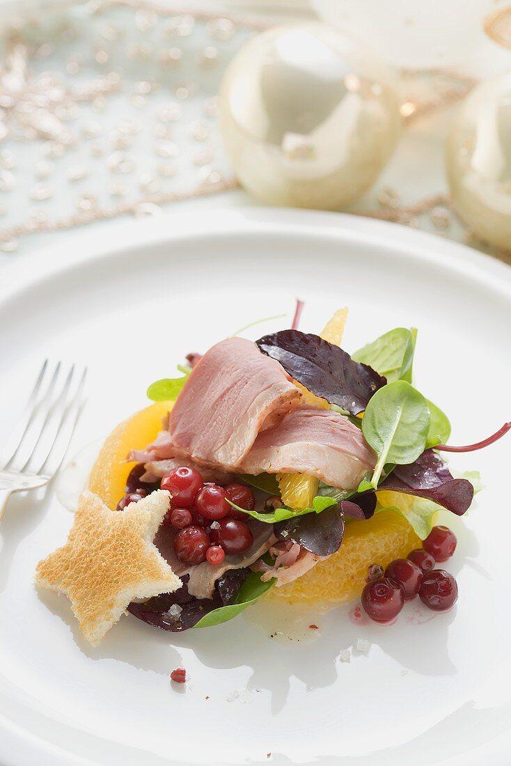 Salad leaves, smoked duck breast, orange segments, toast star