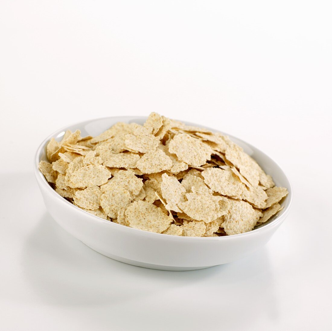 Organic spelt flakes in a dish