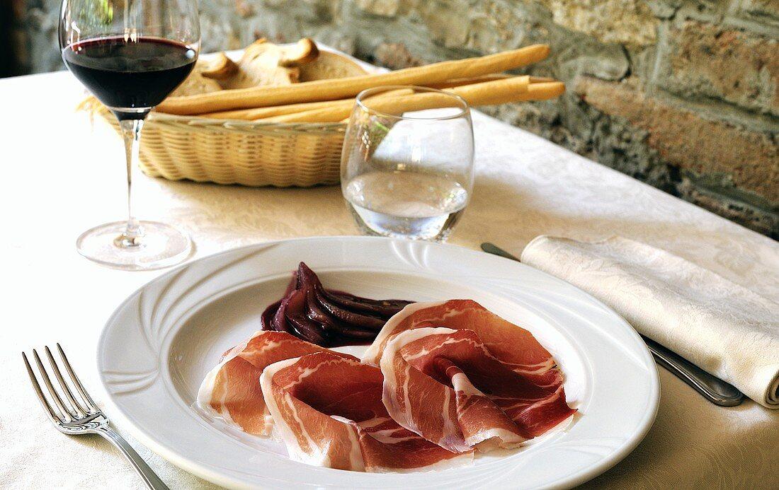 Prosciutto e pera (Raw ham with red wine pears, Italy)