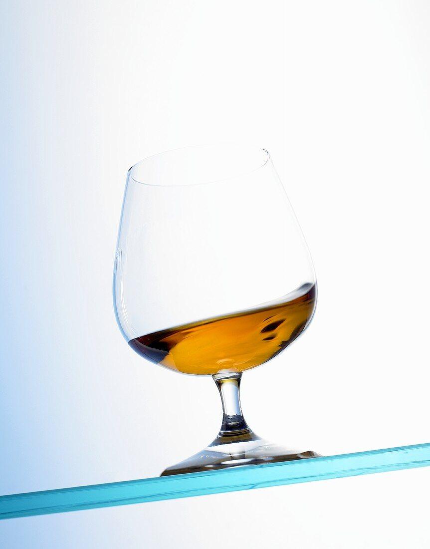 Cognac swirling in a glass