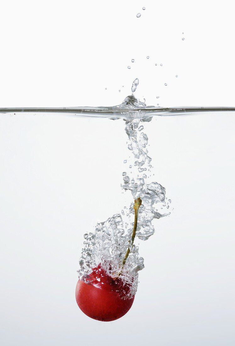 Cherry falling into water