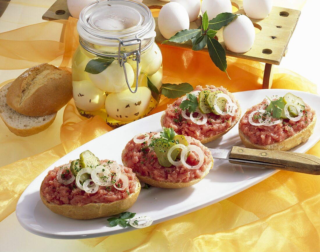 Bread rolls topped with minced pork, pickled eggs