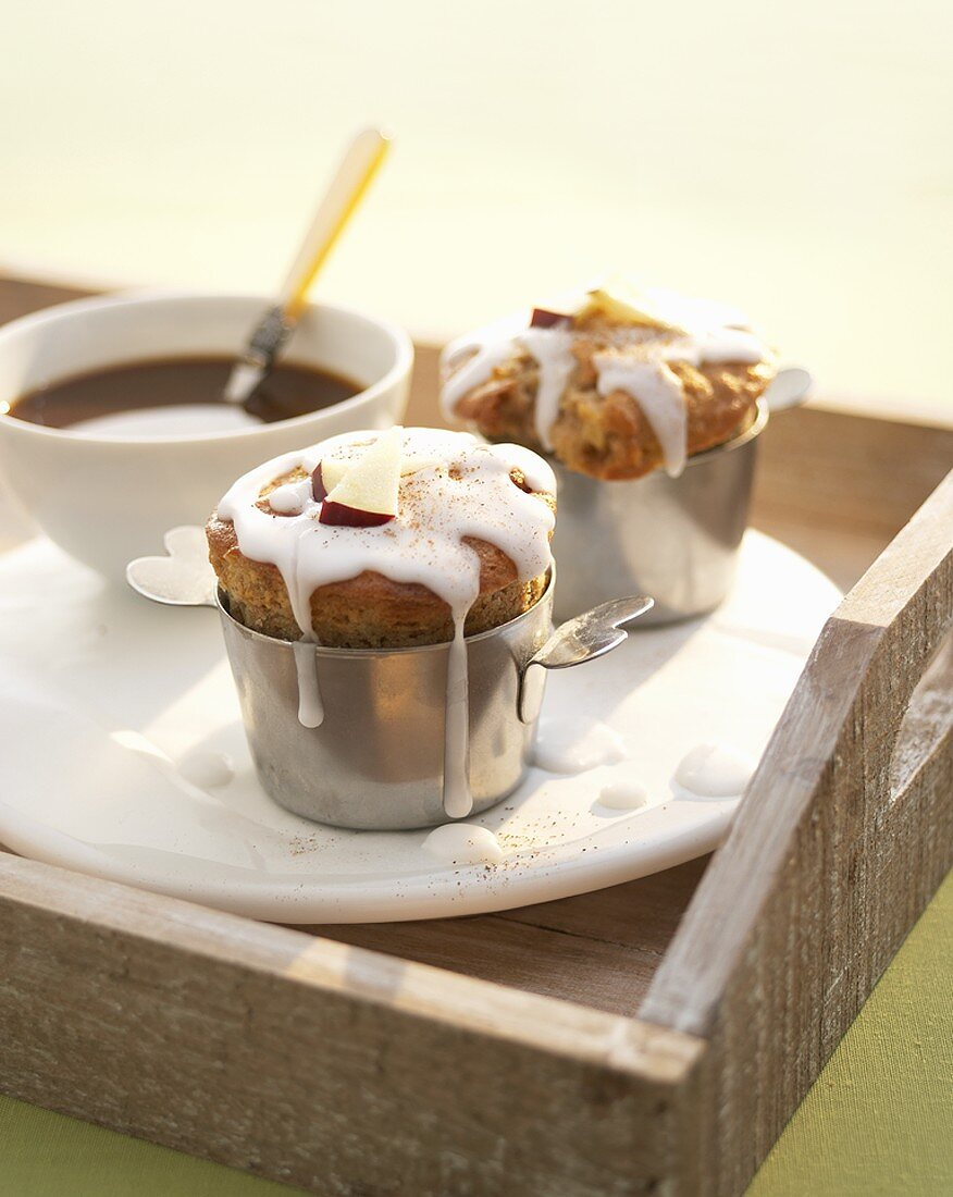 Two apple and cinnamon muffins with coffee