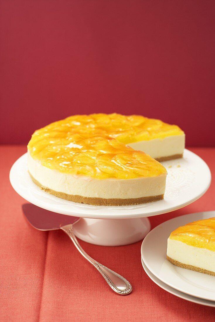 Campari orange cake, a piece taken, on cake stand