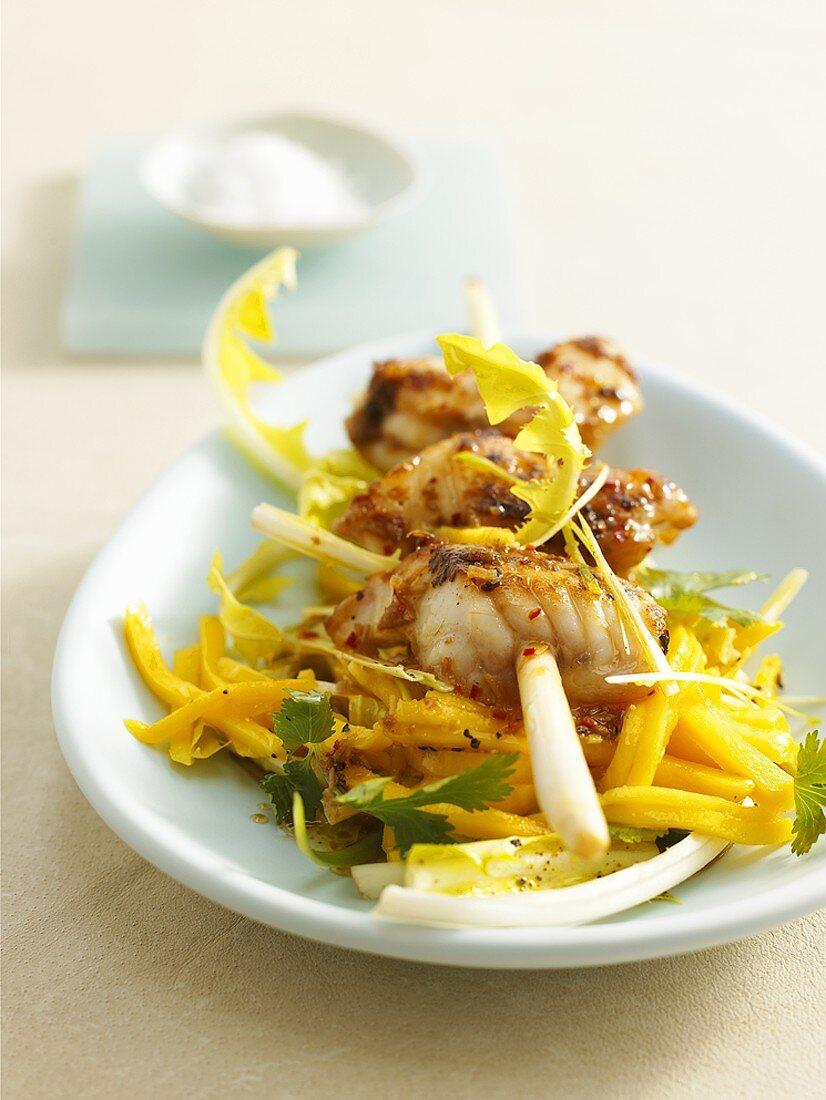 Monkfish skewer on mango salad