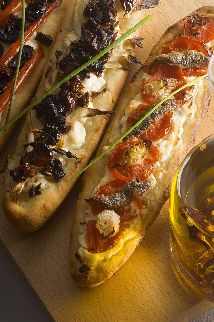 Three different French bread pizzas