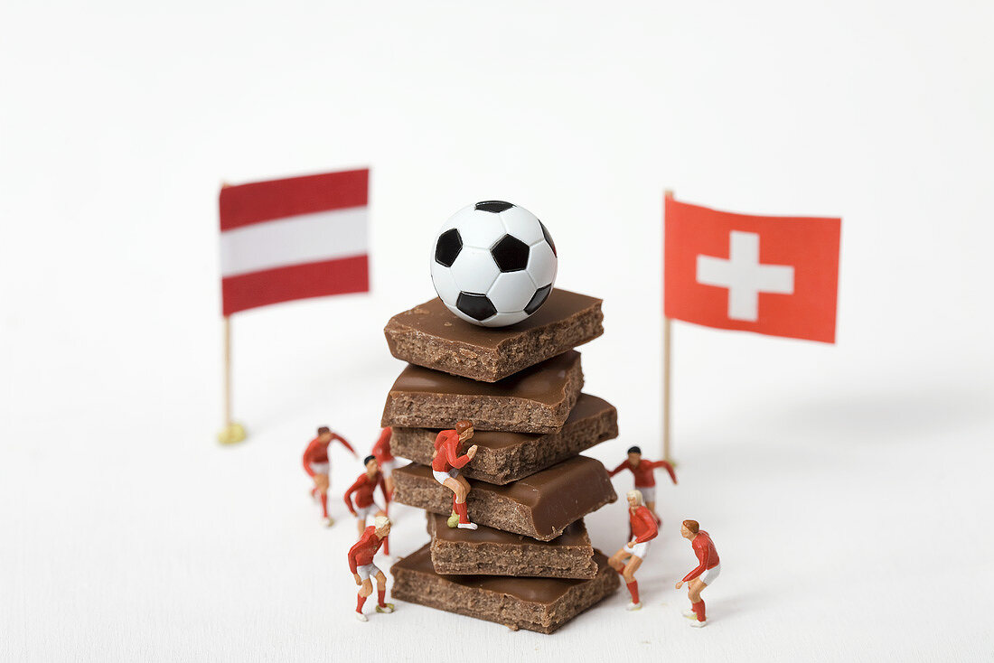 Pieces of chocolate, football, toy footballers, flags