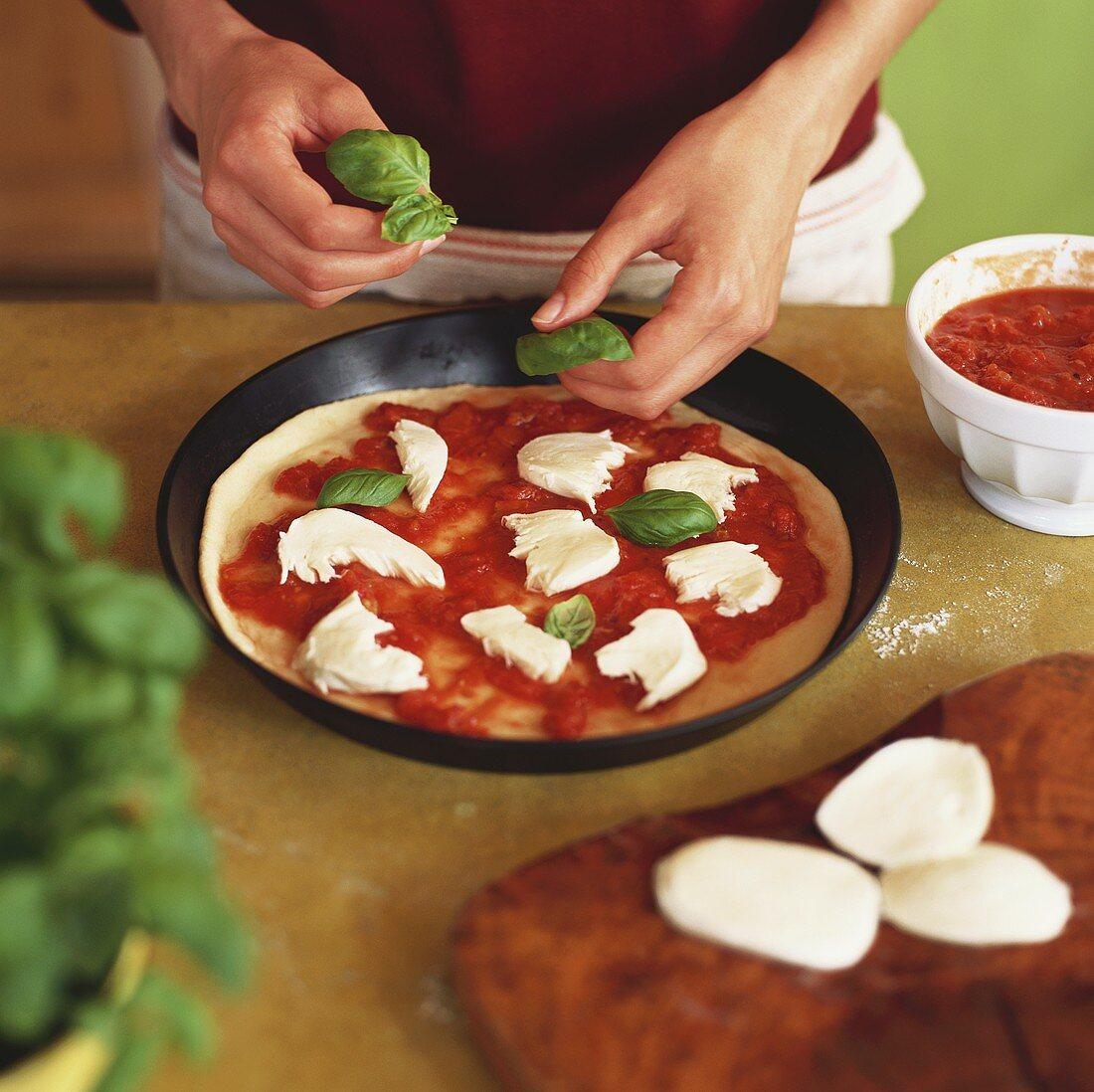 Making Pizza Margherita (adding basil)