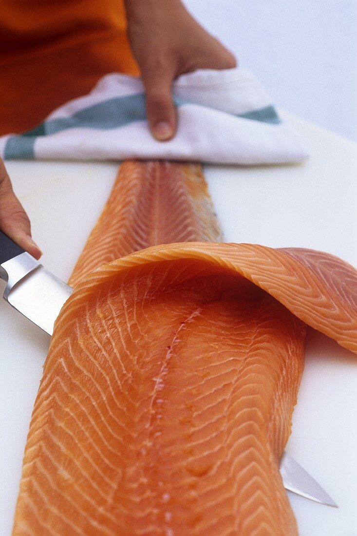 Filleting salmon (removing the skin)