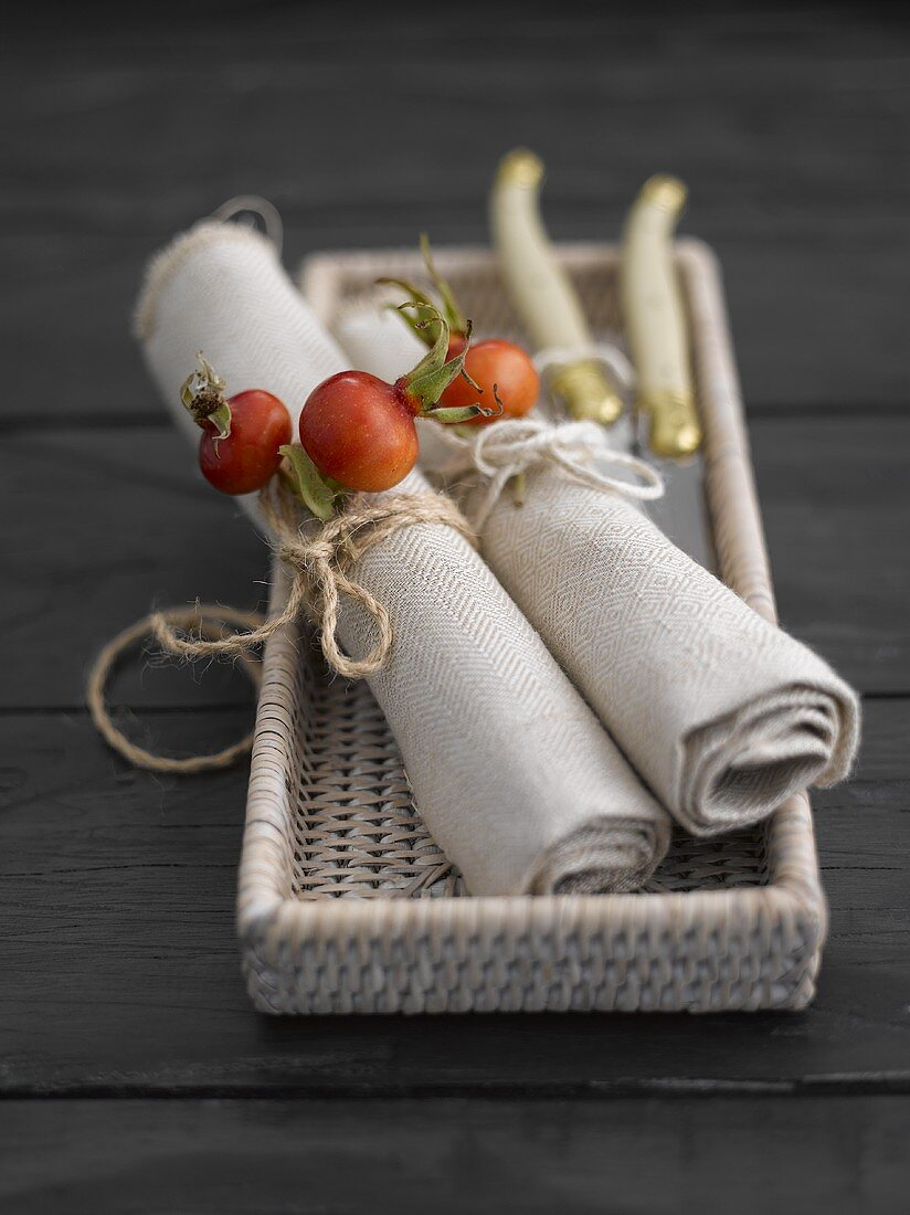 Fabric napkins decorated with rose hips