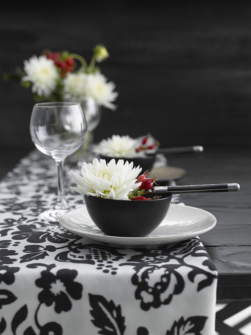 Place-settings with flowers and rose hips
