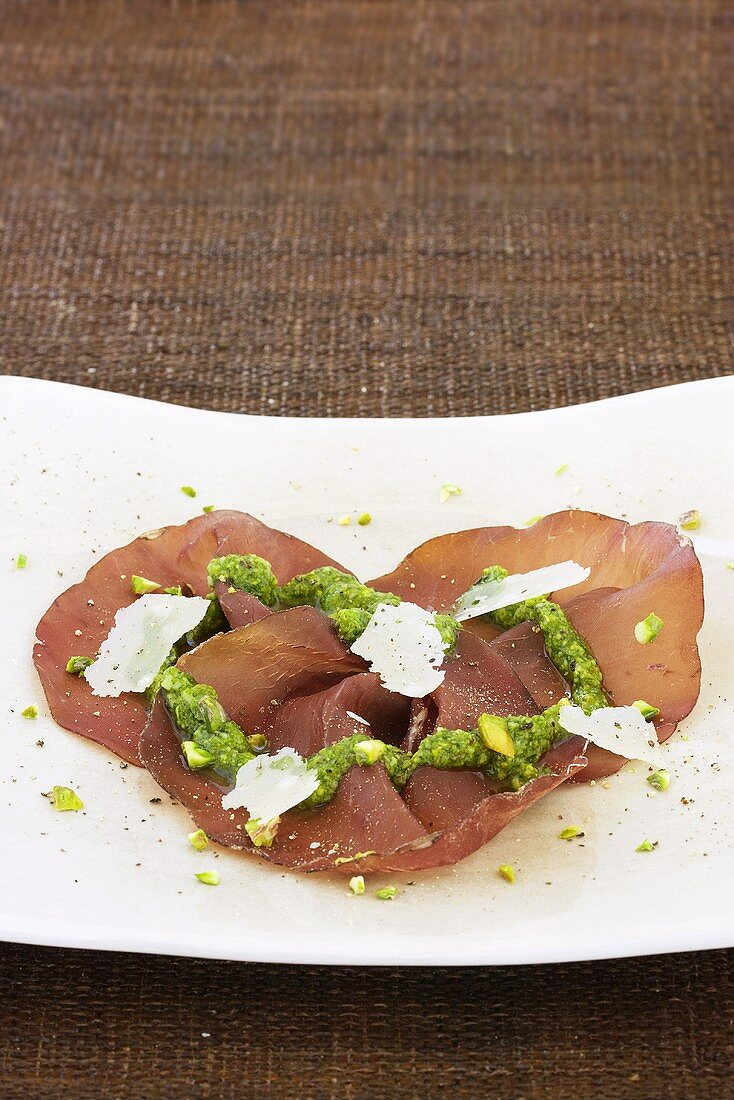 Bresaola with pesto, Parmesan and pistachios