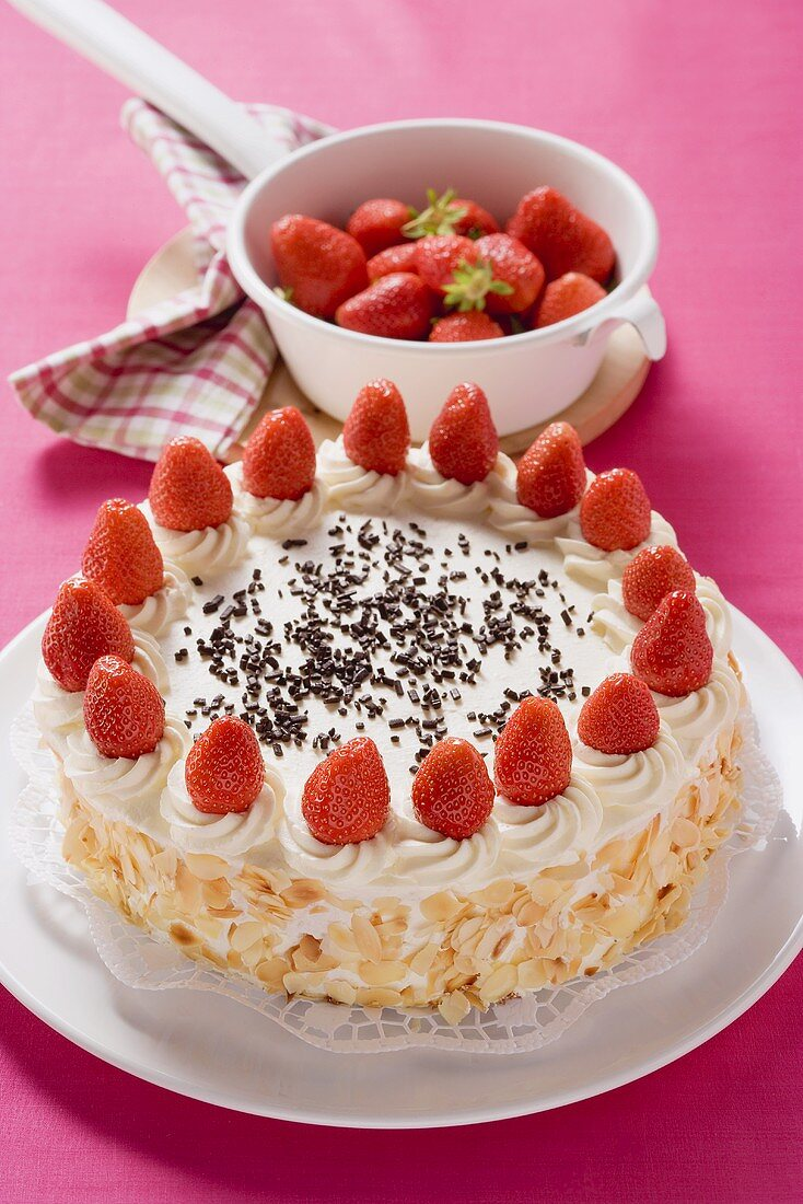 Strawberry cream cake with flaked almonds