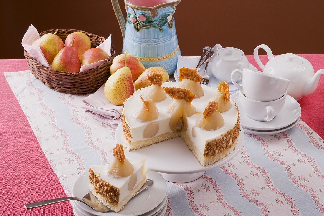 Pear yoghurt cheesecake on cake stand, tea things