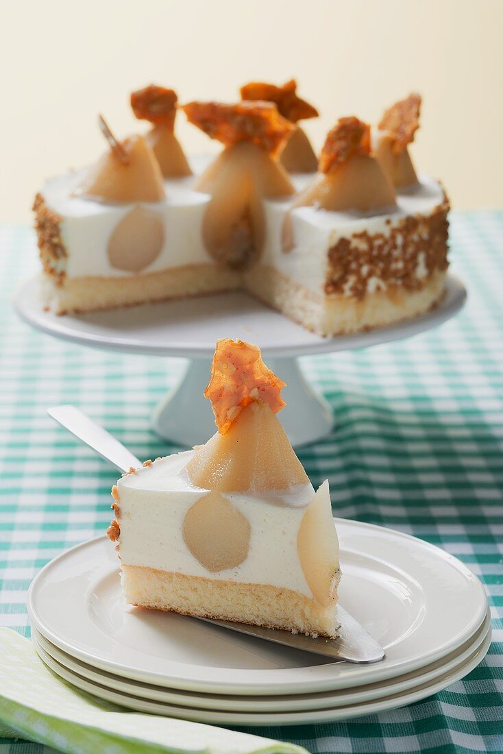 Piece of pear yoghurt cheesecake in front of rest of cake
