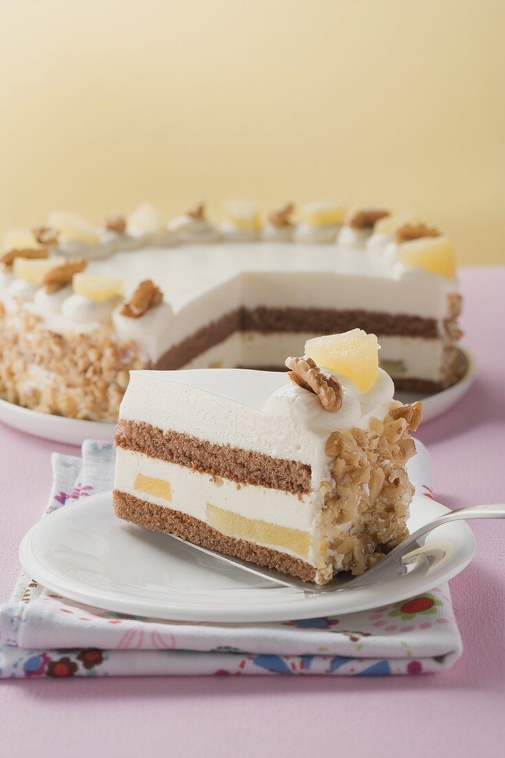 Piece of apple and walnut cake in front of cake