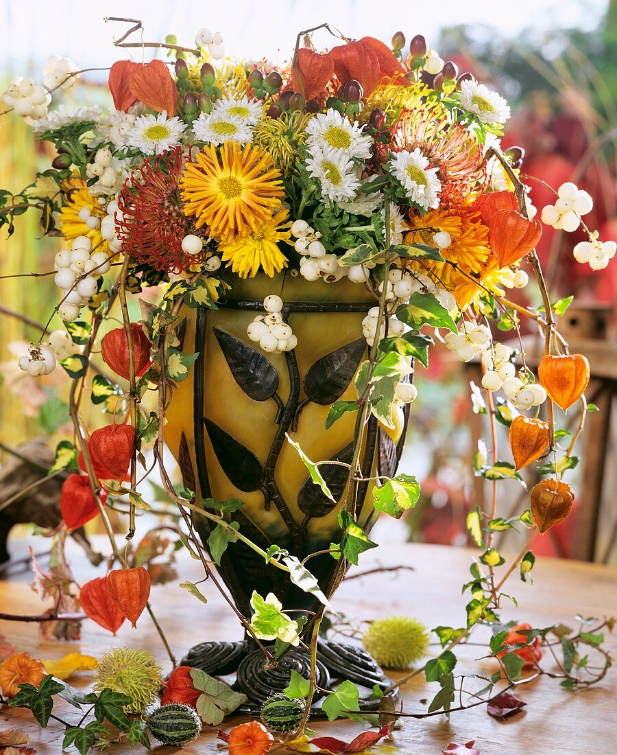 Glass vase of chrysanthemums, Chinese lanterns and Hypericum