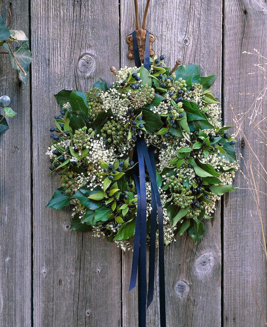 Door wreath of ivy, myrtle and gypsophila