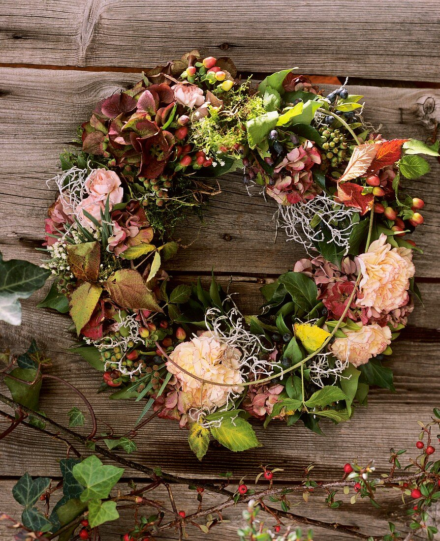 Door wreath with carnations and blackberry shoots