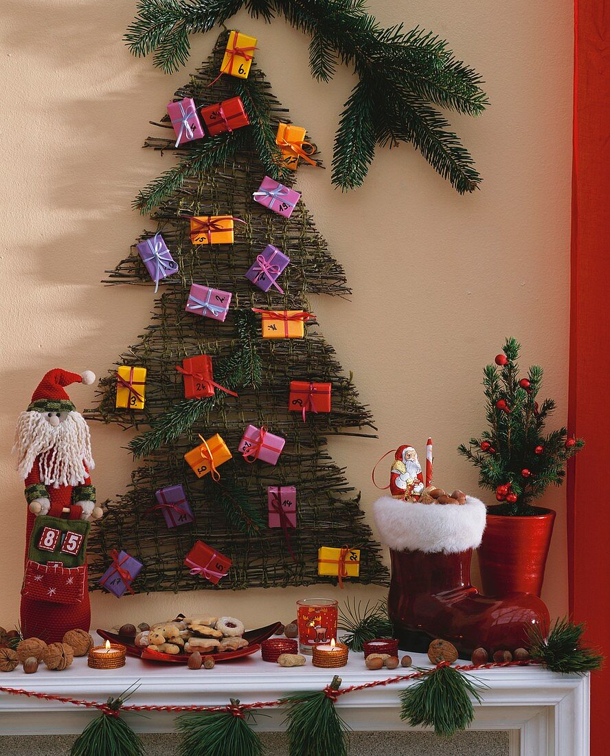 Advent calendar above mantelpiece with Christmas decorations