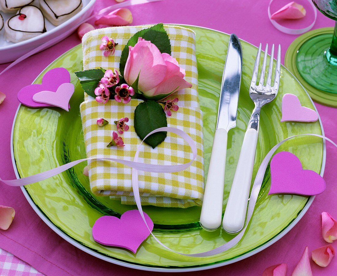Place setting with hearts and roses