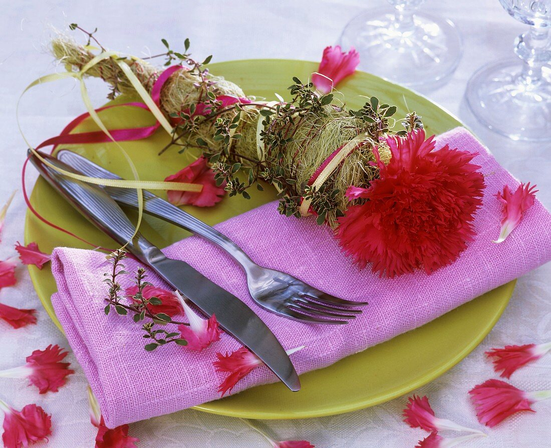 Place-setting decorated with carnation and thyme