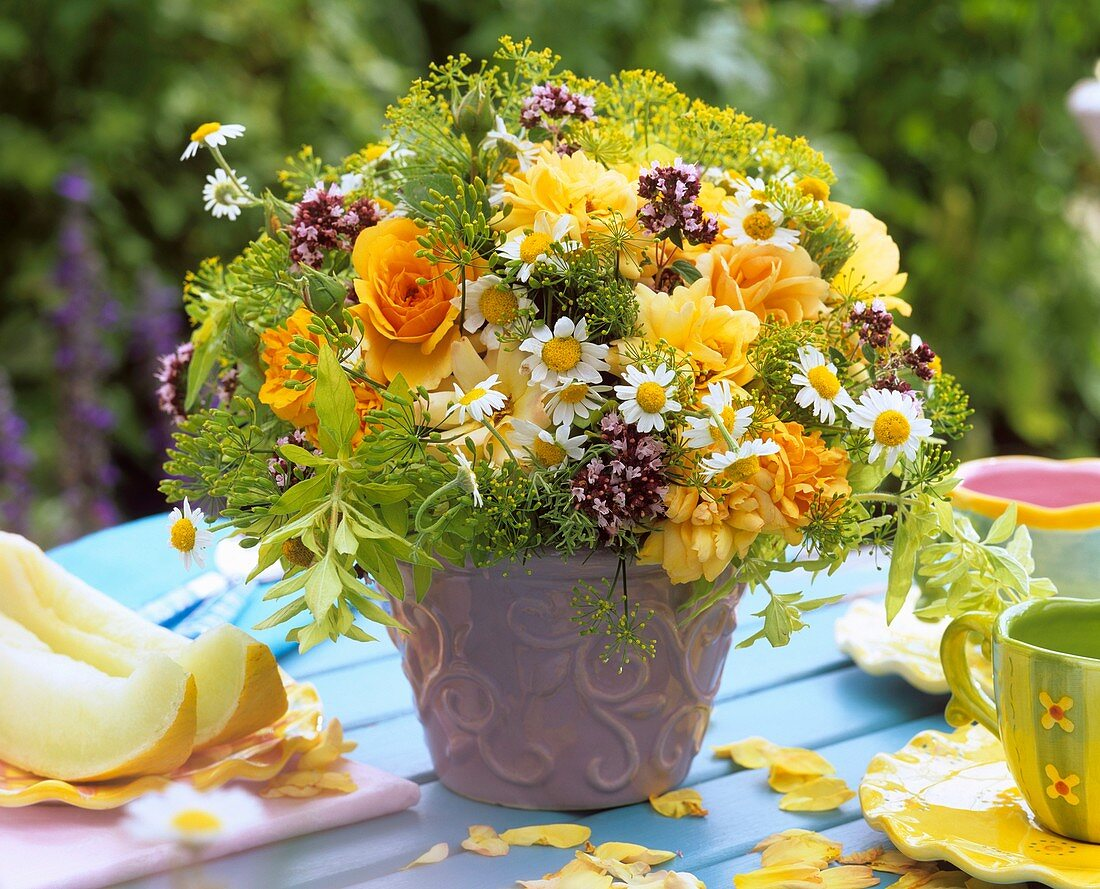 Roses, chamomile, oregano and fennel in a vase