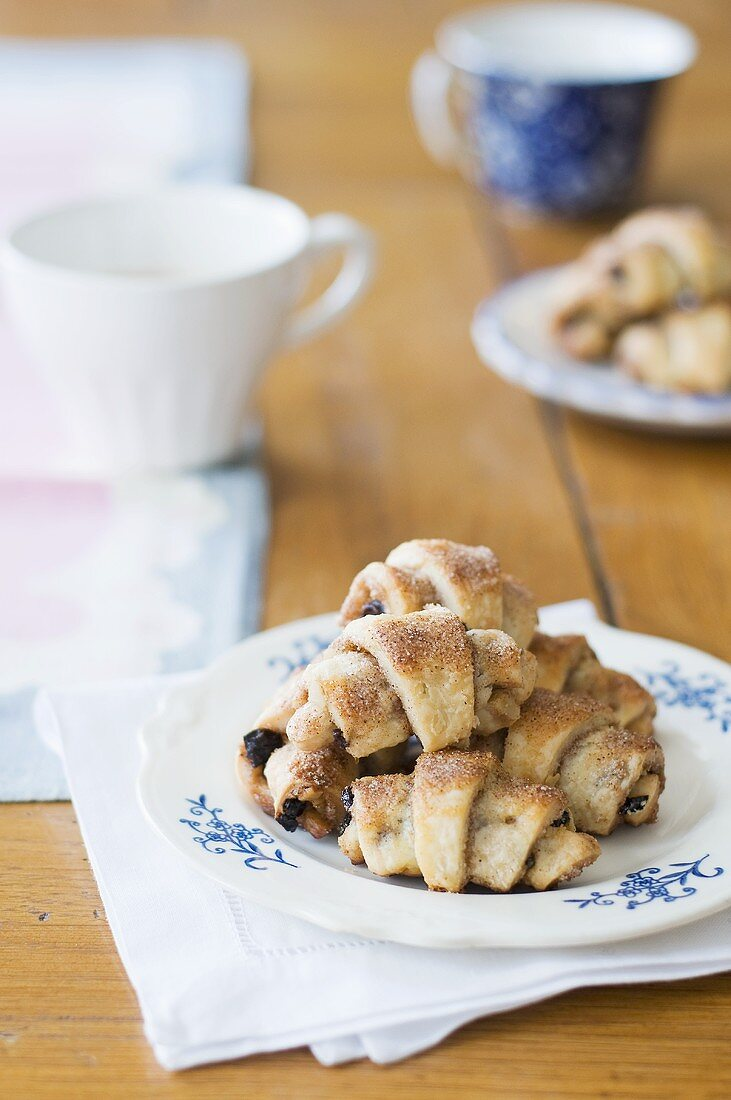 Mini-croissants filled with raisins and strawberry jam