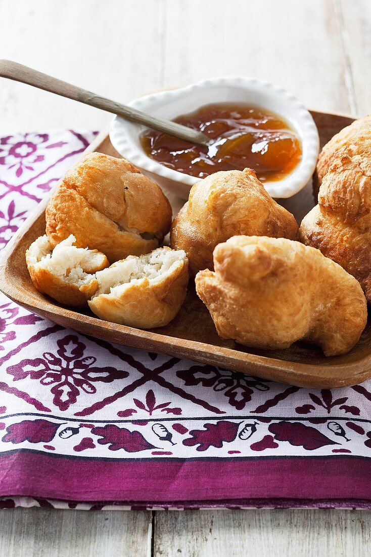 Vetkoek (South African doughnuts) with apricot jam