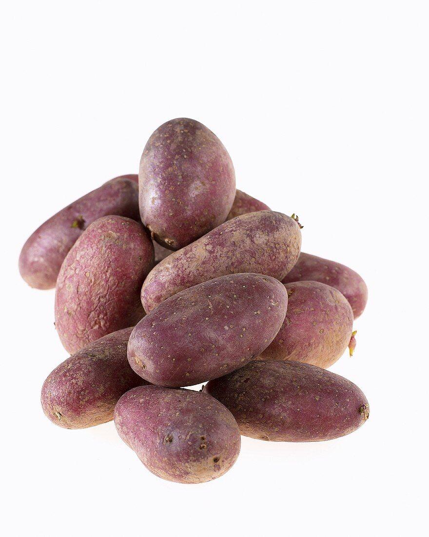 Several potatoes, variety 'Roseval'